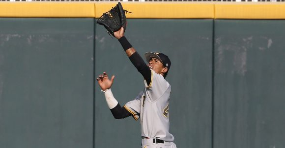 Iowa Hawkeyes outfielder Joel Booker (23) catches a fly ball against the Minnesota Golden Gophers Wednesday, May 25, 2016 at TD Ameritrade Park in Omaha, Neb. (Brian Ray/hawkeyesports.com)